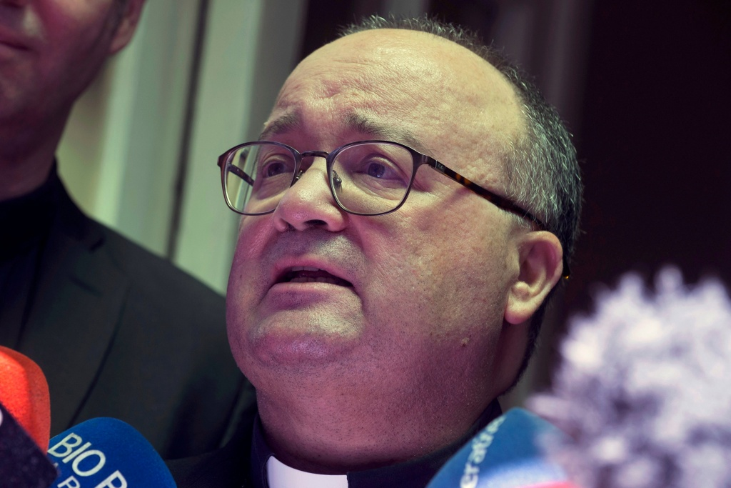 Vatican special envoy Archbishop Charles Scicluna speaks with the media