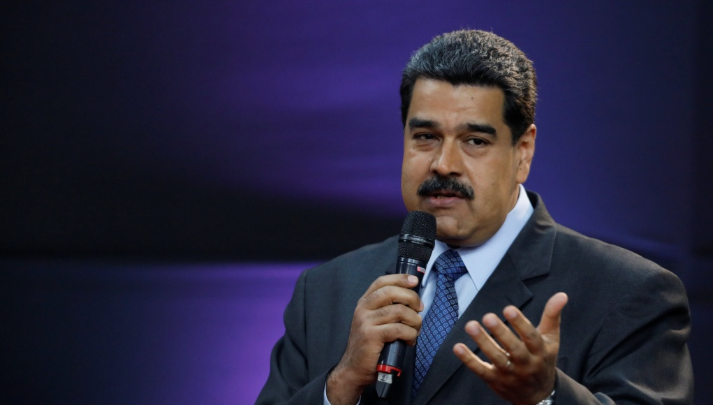 Venezuela's President Nicolas Maduro gestures as he speaks during the event launching the new Venezuelan cryptocurrency