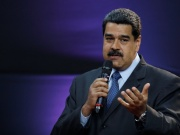"""Venezuela's President Nicolas Maduro gestures as he speaks during the event launching the new Venezuelan cryptocurrency """"petro"""" in Caracas"""