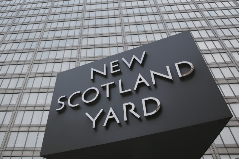 The rotating triangular sign is seen outside New Scotland Yard in central London