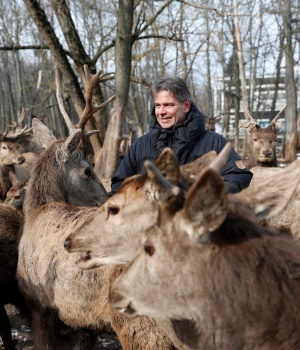 Animal trainer Horkai stands with his Deer at the Animal Training Center in Godollo