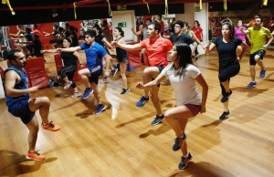 People take part in a session of aerobics in a fitness center at Vina del Mar.