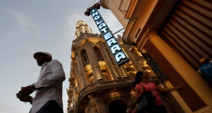 A neon sign shines above the entrance of a the Hotel Inglaterra in Havana