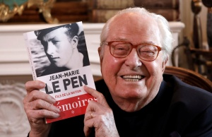 Jean-Marie Le Pen, founder of France's far-right National Front political party, holds his book of memoirs in Montrerout
