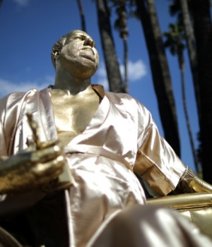 A statue of Harvey Weinstein on a casting couch made by artist Plastic Jesus is seen on Hollywood Boulevard near the Dolby Theatre during preparations for the Oscars in Hollywood, Los Angeles