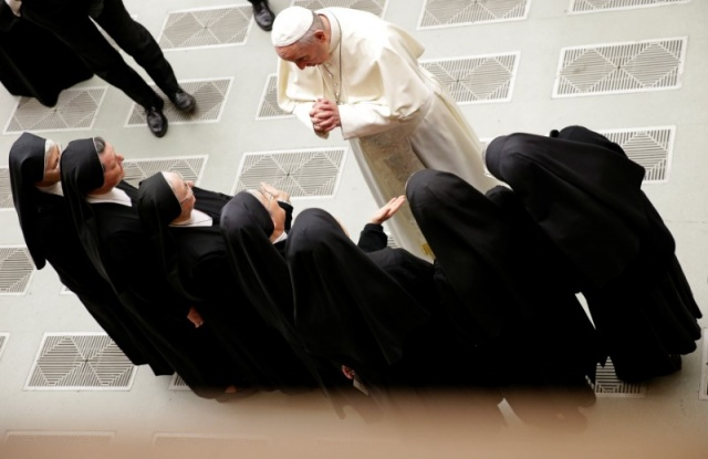 Pope Francis greets a group of nuns during the general audience in Paul VI hall at the Vatican