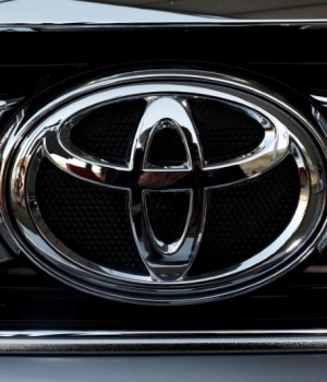 A Toyota Motor Corp. logo is seen on a car at the International Auto Show in Mexico City