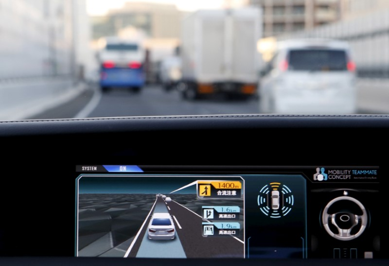 "An onboard display monitor shows other vehicles as a staff member of Toyota Motor Corp drives its self-driving technology ""Mobility Teammate Concept"" prototype car hands-free on the Metropolitan Expressway in Tokyo"