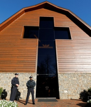 Police officers stand guard in front of the Billy Graham Library before the start of the funeral for evangelist Billy Graham in Charlotte, North Carolina