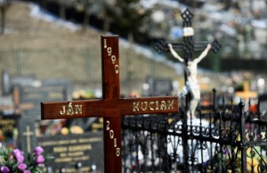 A cross is in the cemetery for the funeral of investigative reporter Jan Kuciak, who was murdered along with his fiance Martina Kusnirova, in the village of Stiavnik