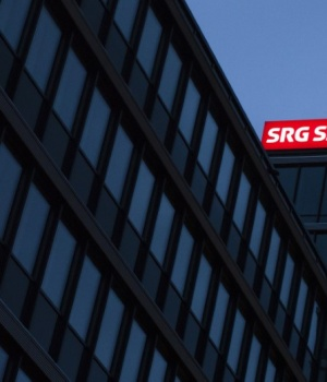 The illuminated logo of Swiss radio and television SRG SSR is pictured on a building in Bern