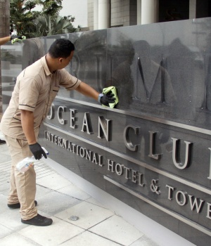 Worker cleans the site where the Trump name was removed from the Trump Ocean Club International Hotel and Tower in Panama City,