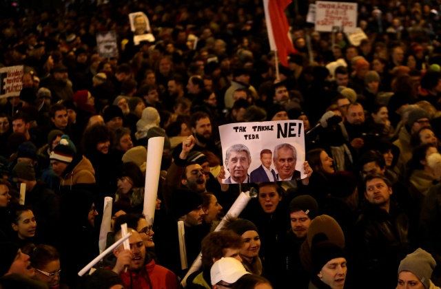 Demonstrators hold banners during a protest rally opposing the appointment of Communist member of parliament Zdenek Ondracek to chair a committee that oversees Czech police inspection in Prague