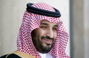 Saudi Arabia's then Deputy Crown Prince Mohammed bin Salman reacts upon his arrival at the Elysee Palace in Paris
