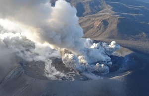 An aerial view shows Shinmoedake peak erupting between Miyazaki and Kagoshima prefectures