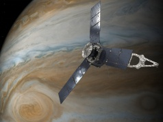 NASA handout of an illustration depicting the U.S. space agency's Juno spacecraft in orbit above Jupiter's Gread Red Spot.