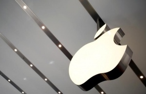 Apple logo is pictured inside the newly opened Omotesando Apple store at a shopping district in Tokyo, Japan