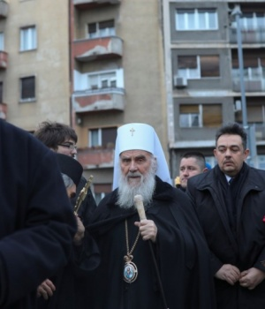 Serbian patriarch Irinej walks in front of the St. Sava temple on Orthodox Christmas Eve in Belgrade