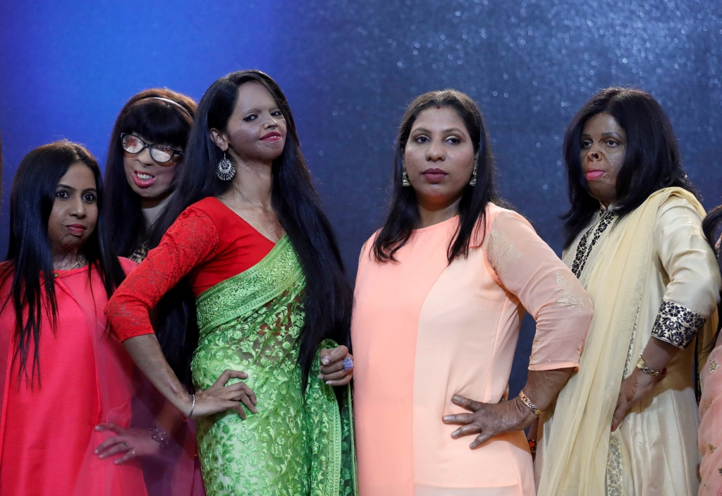 Acid attack survivors pose during a fashion show to mark International Women's Day in Thane on the outskirts of Mumbai