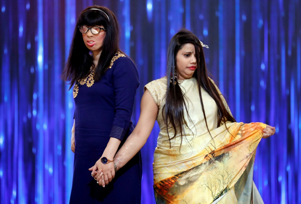 Acid attack survivors walk on the runway during a fashion show to mark International Women's Day in Thane on the outskirts of Mumbai
