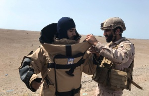 A member of the UAE armed forces is getting ready before searching for landmines in Al-Mokha