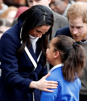 Britain's Prince Harry and his fiancee Meghan Markle meet local school children during a wakabout on a visit to Birmingham