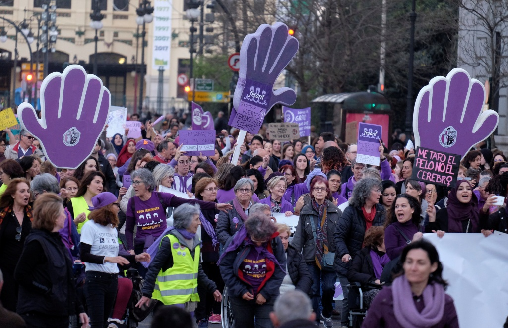 eople march during a demonstration as part of a nationwide feminist strike on International Women's Day in Valencia