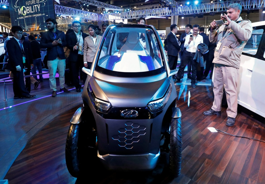 Mahindra showcases its electric two-seater vehicle UDO at the India Auto Show 2018 in Greater Noida