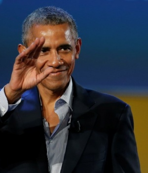 Former U.S. President Barack Obama waves after speaking at the Global Food Innovation Summit in Milan