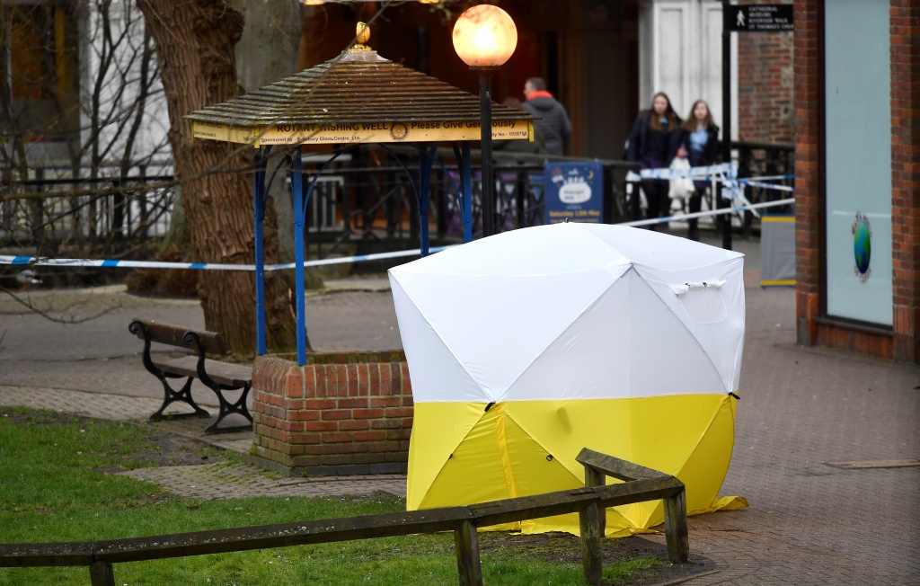 A forensics tent covers the bench, where Sergei Skripal and his daughter Yulia were found slumped, in a cordoned off area in the centre of Salisbury