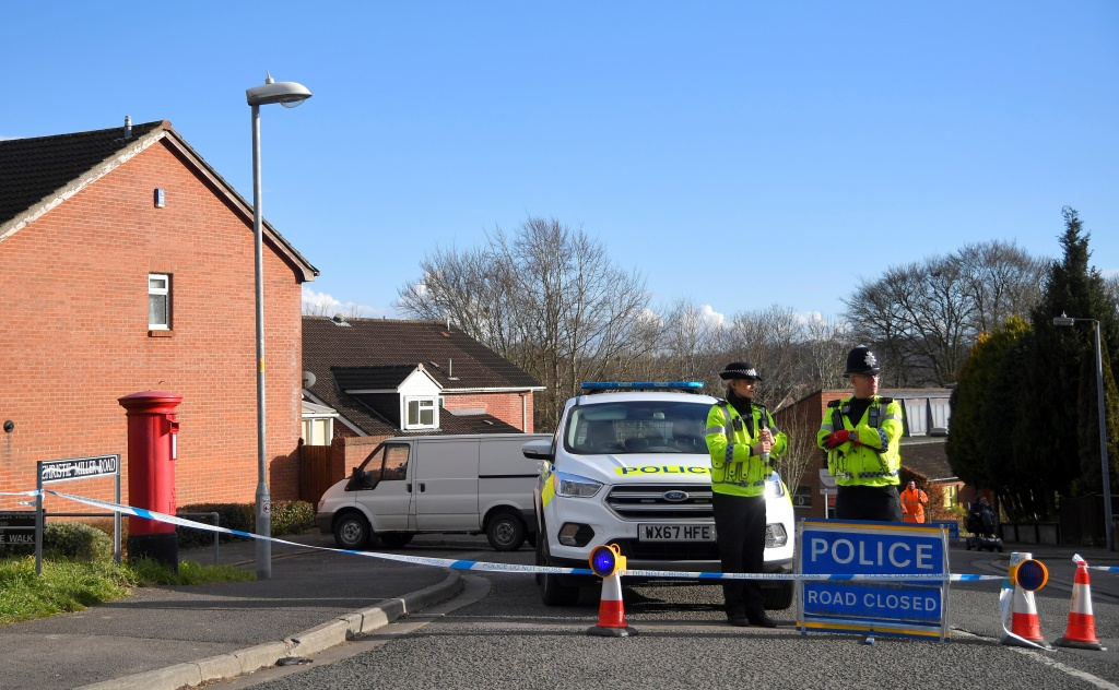 Police officers seal off the road on which Russian Sergei Skripal lives in Salisbury