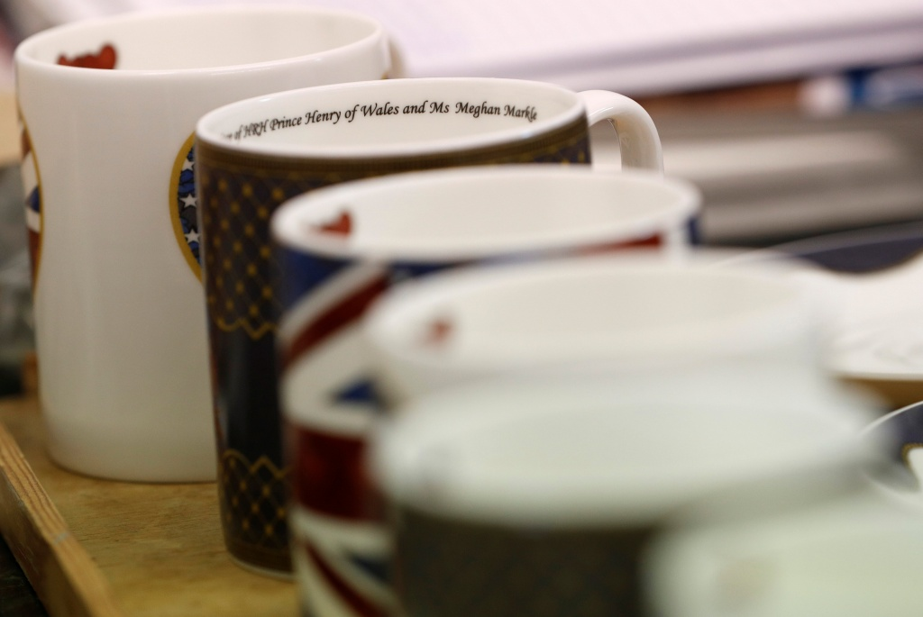 Mugs made to celebrate the Royal Wedding between Prince Harry and Meghan Markle wait to be guilded at Halcyon Days' Caverswall factory in Stoke-on-Trent