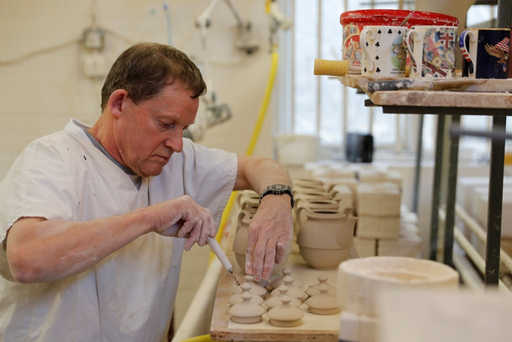 Bench Caster Steve Mason works on teapots made to celebrate the Royal Wedding between Prince Harry and Meghan Markle at Halcyon Days' Caverswall factory in Stoke-on-Trent