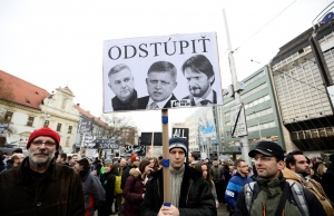 "Demonstrator holds a placard reading ""Resign"" during a protest called ""Let's stand for decency in Slovakia"" in Bratislava"
