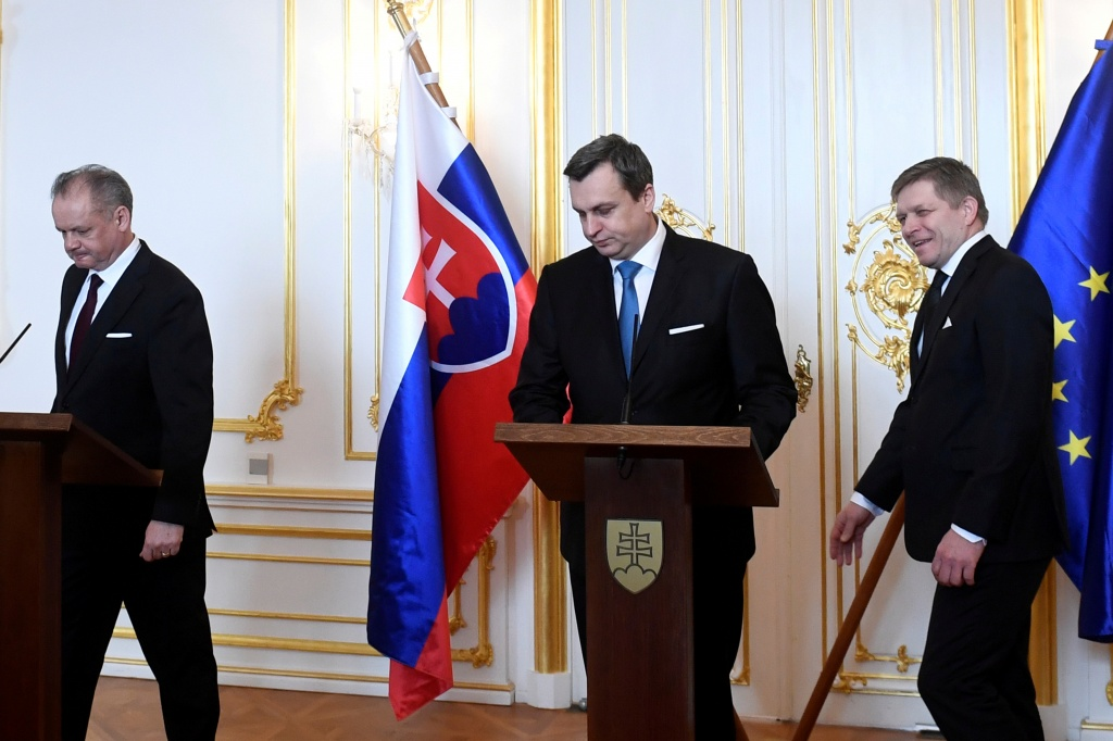 Slovakia's President Andrej Kiska, Speaker of the Slovakia's National Council Andrej Danko and Slovakia's Prime Minister Robert Fico react after a meeting at the Bratislava Castle