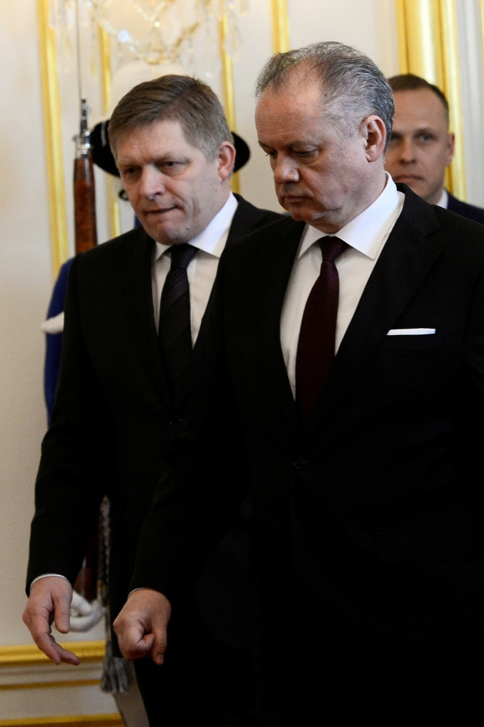 Slovakia's President Andrej Kiska and Slovakia's Prime Minister Robert Fico react after a meeting at the Bratislava castle