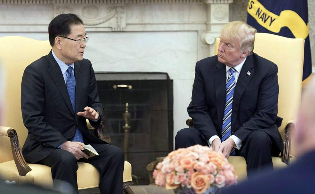 South Korea national security chief Chung Eui-yong briefs U.S. President Donald Trump at the Oval Office