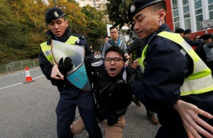 A pro-democracy protester is taken away by the police in Hong Kong