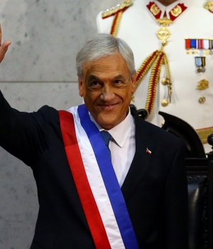 Chile's President Sebastian Pinera waves after being sworn in at the Congress in Valparaiso