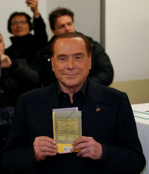 Forza Italia party leader Silvio Berlusconi casts his vote at a polling station in Milan