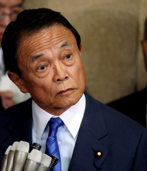Japan's Deputy Prime Minister and Finance Minister Taro Aso speaks to reporters in Tokyo