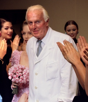 French fashion designer Hubert de Givenchy is applauded by the models after he presented his last High Fashion collection Autumn/Winter 1995 in Paris