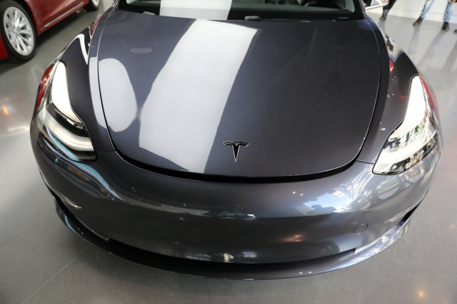 A Tesla Model 3 is seen in a showroom in Los Angeles
