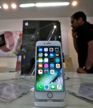 An iPhone is seen on display at a kiosk at an Apple reseller store in Mumbai