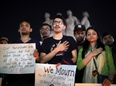 Nepali students of University of Dhaka hold placards in memory of the victims of the US-Bangla aircraft crash, in Dhaka