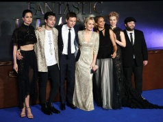 "Writer J.K. Rowling poses with members of the cast as they arrive for the European premiere of the film ""Fantastic Beasts and Where to Find Them"" at Cineworld Imax, Leicester Square in London"