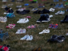 Activists install 7000 shoes on the lawn in front of the U.S. Capitol on Capitol Hill in Washington
