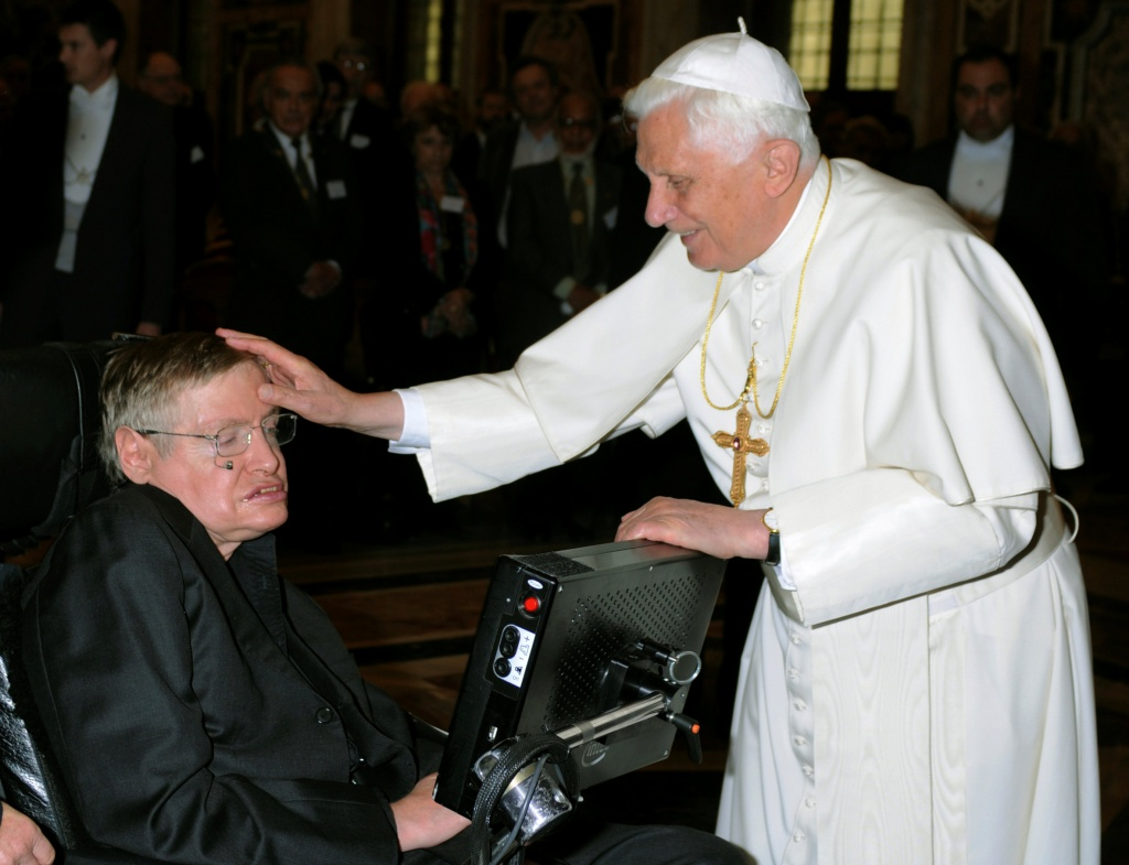 Pope Benedict XVI greets British professor Hawking during a meeting of science academics at the Vatican