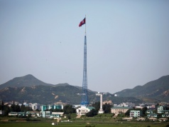 A North Korean flag flutters on top of a tower at the propaganda village of Gijungdong in North Korea, in this picture taken near the truce village of Panmunjom
