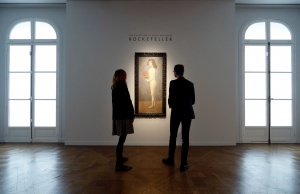 Christie's employees stand next to 'Fillette a la corbeille fleurie' by Pablo Picasso from the collection of Peggy and David Rockefeller during a sale preview at Christie's auction house in Paris